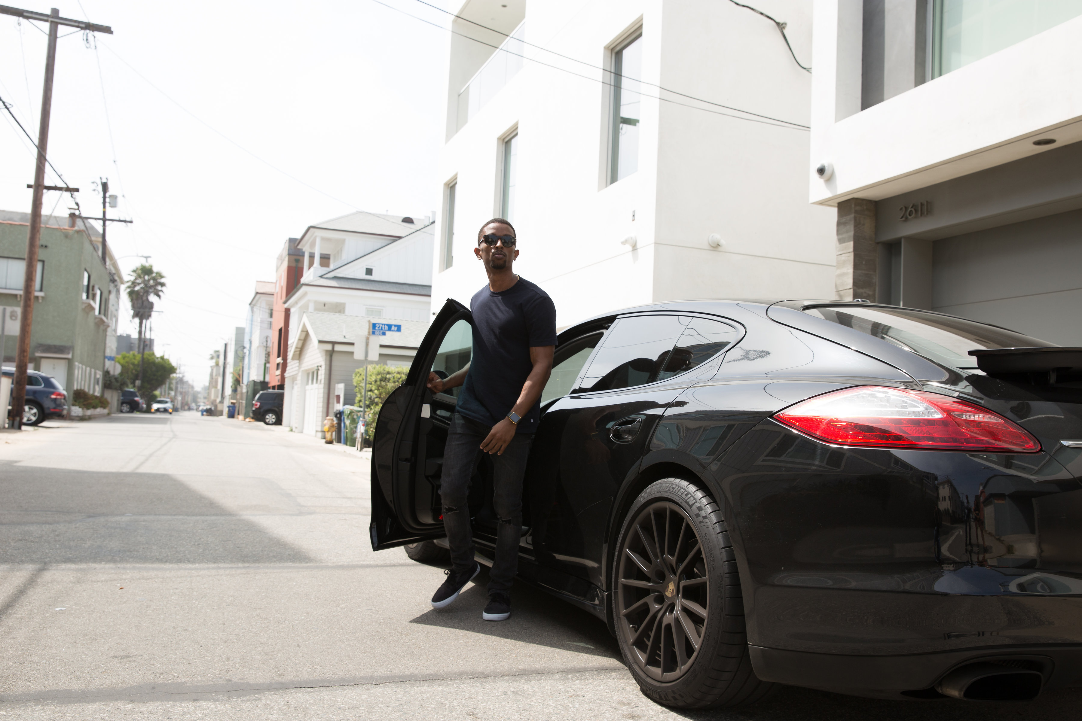 Kevin L. Walker exiting his Porsche Panamera at Venice Beach