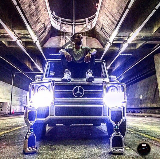 Kevin L. Walker - Sitting on his Mercedes GWagon (2014)